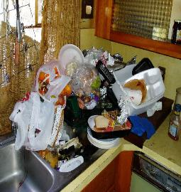 Rotting food & other trash in gross filth hoarding kitchen